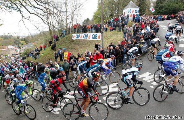 "BMC Racing Team rider Gilbert of Belgium climbs the ""Wall of Huy"" during the Fleche Wallonne Classic cycling race in Huy"