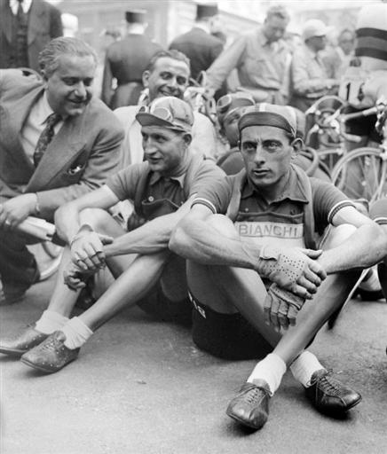 gino-bartali-l-and-fausto-coppi-r-waiting-before-the-start-of-a-stage-of-the-tour-de-france