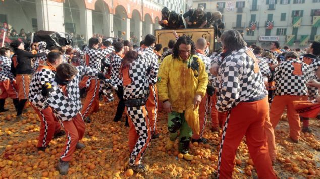 Italians hold a orange battle during carnival in the northern Italian town of Ivrea